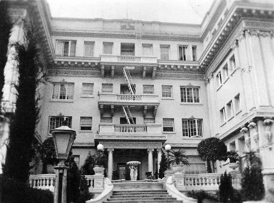 N D View Of The Front Entrance To Garden Court Apartments A Beautiful Staircase Leads Fountain Containing Two Figures Holding Up Bowl