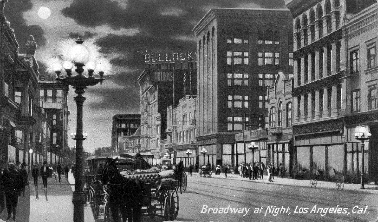 (ca. 1908)*^u2013 Postcard view looking south on Broadway at night with the Bullocku0027s Department Store building in the background. An ornate 7-bulb l& stands ... & Water and Power Associates