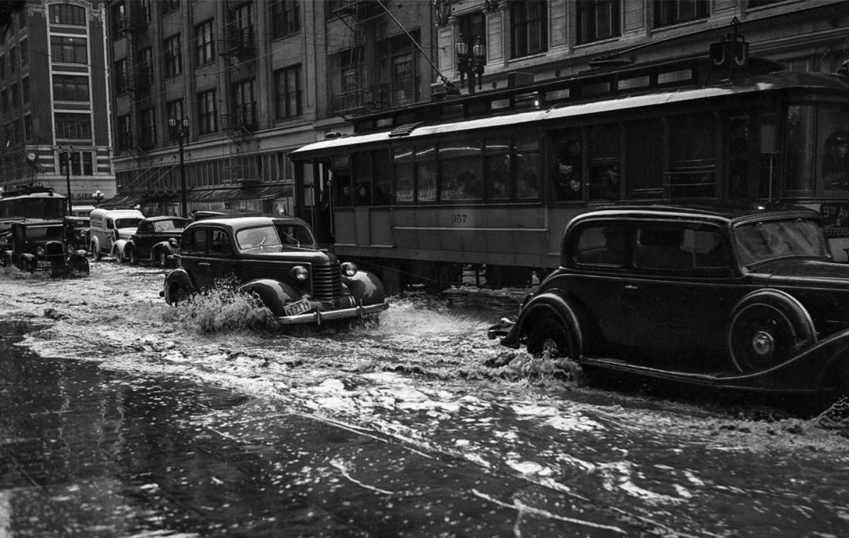 1938 original photo caption reads drains could not keep up with rain filling streets in downtown los angeles march 2 1938