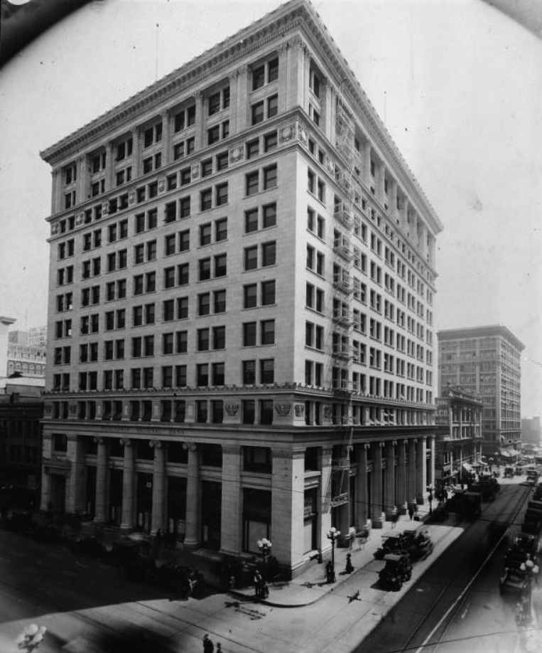 (ca. 1920)^^ - View showing the Merchants National Bank located on the northeast corner of Spring and 6th streets.