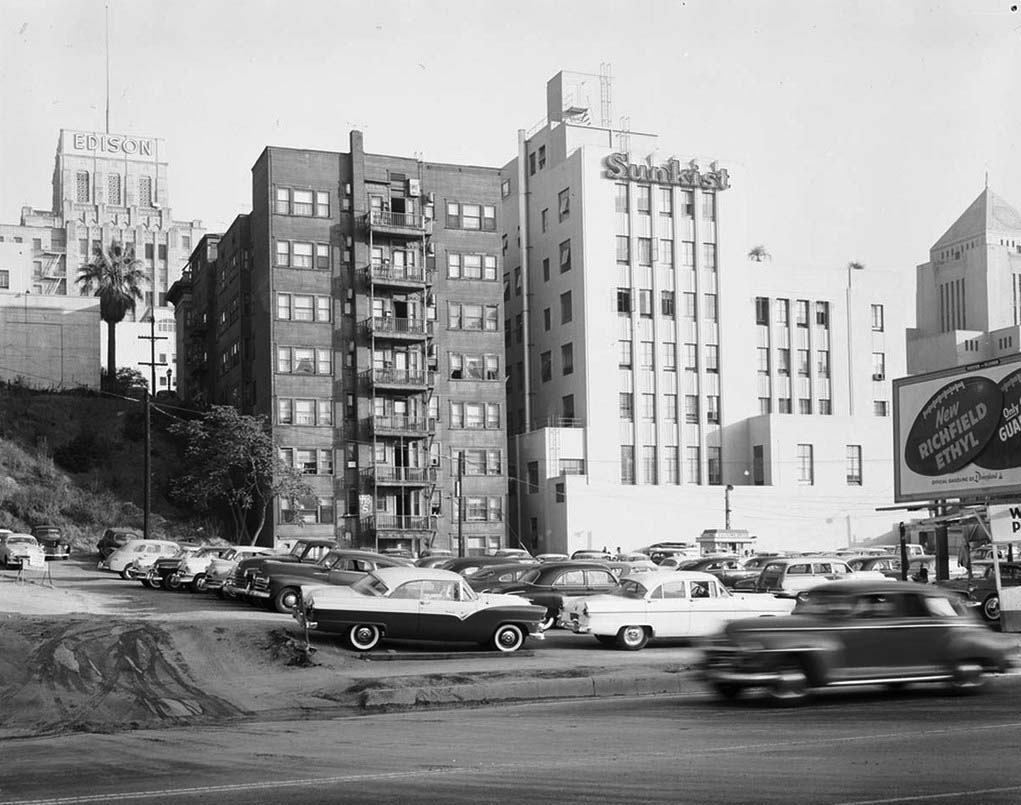 water and power associates 1955 view looking east from figueroa street showing the side of the sunkist building with the la central library to its right across 5th street