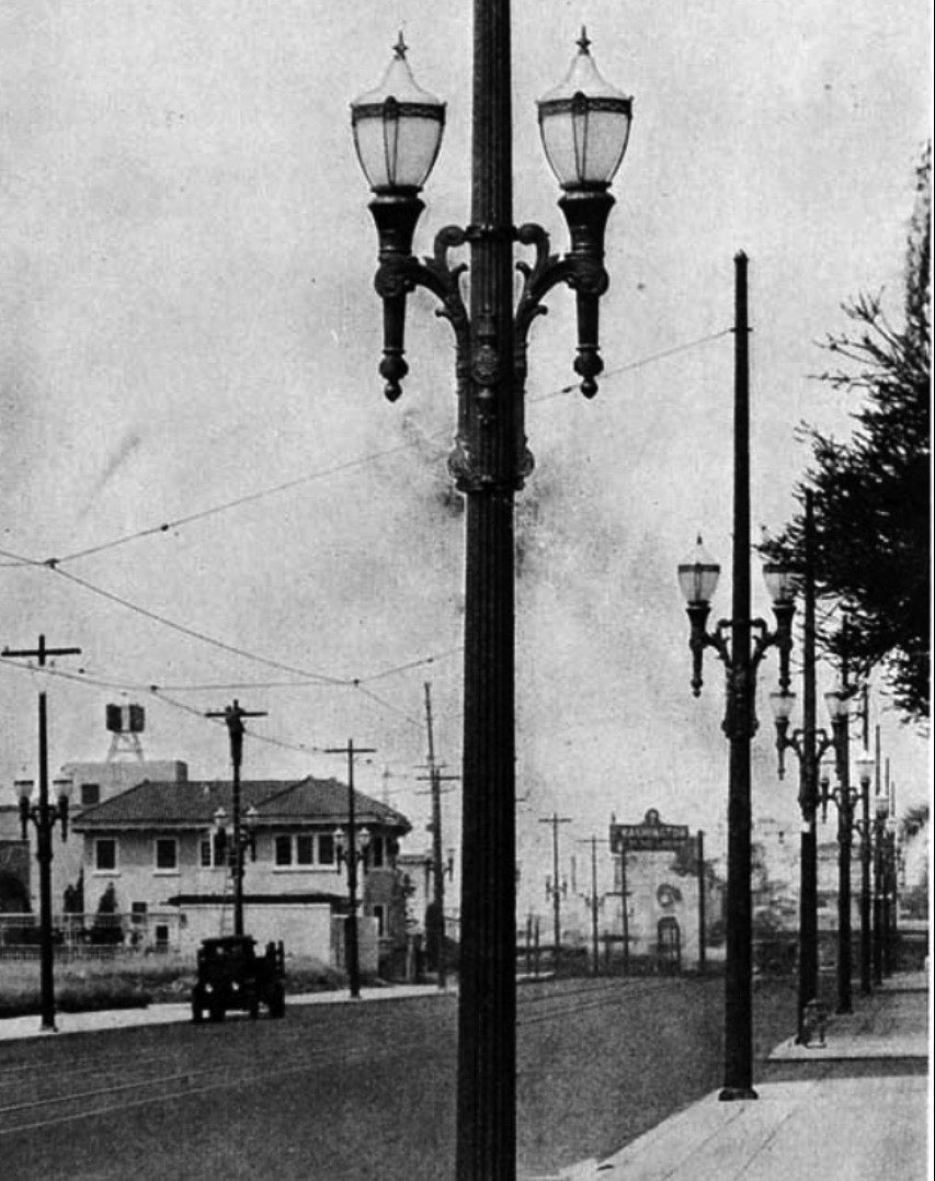 Water and power associates 1931x close up detailed view showing the ornate design of the dual lamp electrolier note the utility worker high up on the streetlight post across arubaitofo Image collections