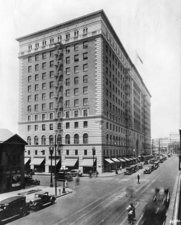 1926 view looking southwest showing the barker brothers furniture store building located at 818 w 7th st cars are moving along seventh st and barker furniture