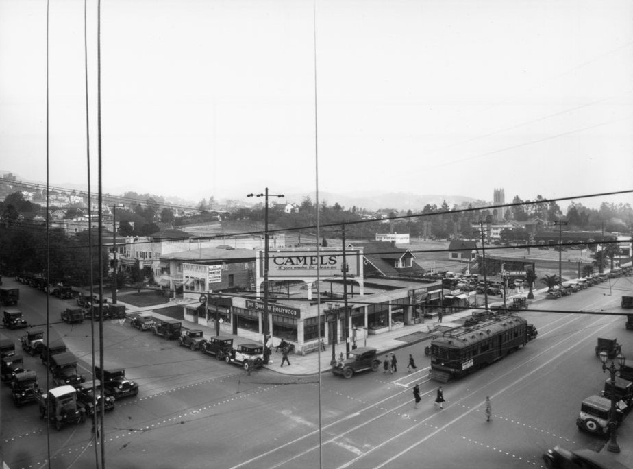 (1927)^   View Looking Toward The Northeast Corner Of Hollywood Boulevard  And Vine Street. Pedestrians Cross The Street As Autos And Streetcar Wait  For ...