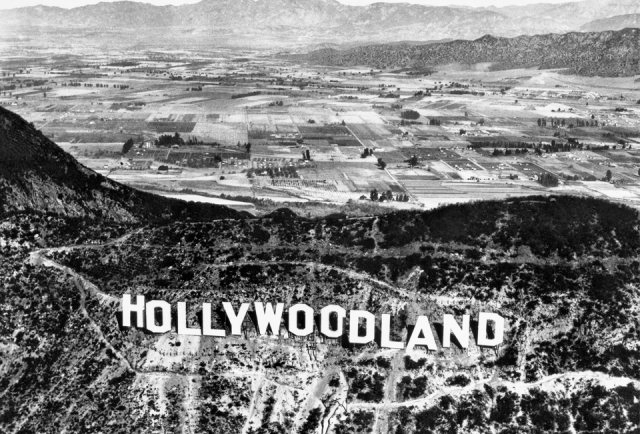 84abdf75977f (ca. 1920s)   - The HOLLYWOODLAND sign was erected in 1923 to advertise a  new housing development in the hills above the Hollywood district of Los  Angeles.