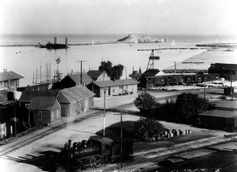 6440dfd5db ... View looking over a portion of San Pedro, toward Deadman's Island, and  the beginning harbor. Building at extreme left is the Southern Pacific depot .